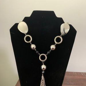 Long silver necklace with beads and charms